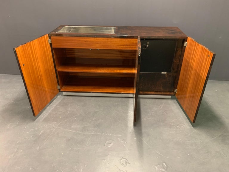 Lacquered goatskin sideboard on chrome base, designed by Aldo Tura, circa 1970. Shelf and a chrome bar on top.
