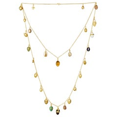 Wonderful Antique Collection of Egg Pendants Suspended from a Gold Necklace