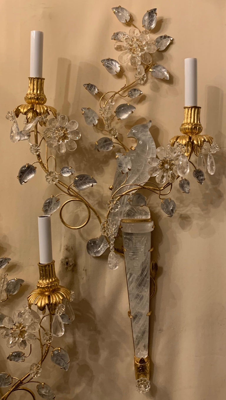 A wonderful pair of chinoiserie motif rock crystal two-arm with new candelabra sockets and wiring gilt bird form parrot sconces with flowers.  3 pairs available Each pair sold separately.