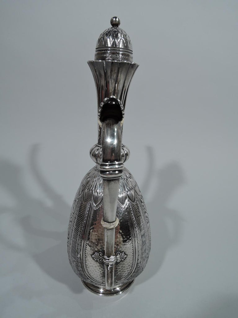 Exotic sterling silver Turkish coffeepot. Made by Gorham in Providence in 1881. Flat ovoid body with lobed knop, tapering cylindrical neck with twisted fluting and scalloped rim, inset hinged domed cover, s-scroll handle, and vertical s-spout.