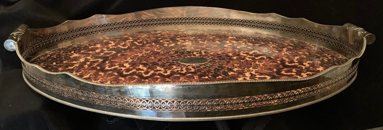 A wonderful large faux tortoiseshell and silver plated oval pierced gallery tray with handles.