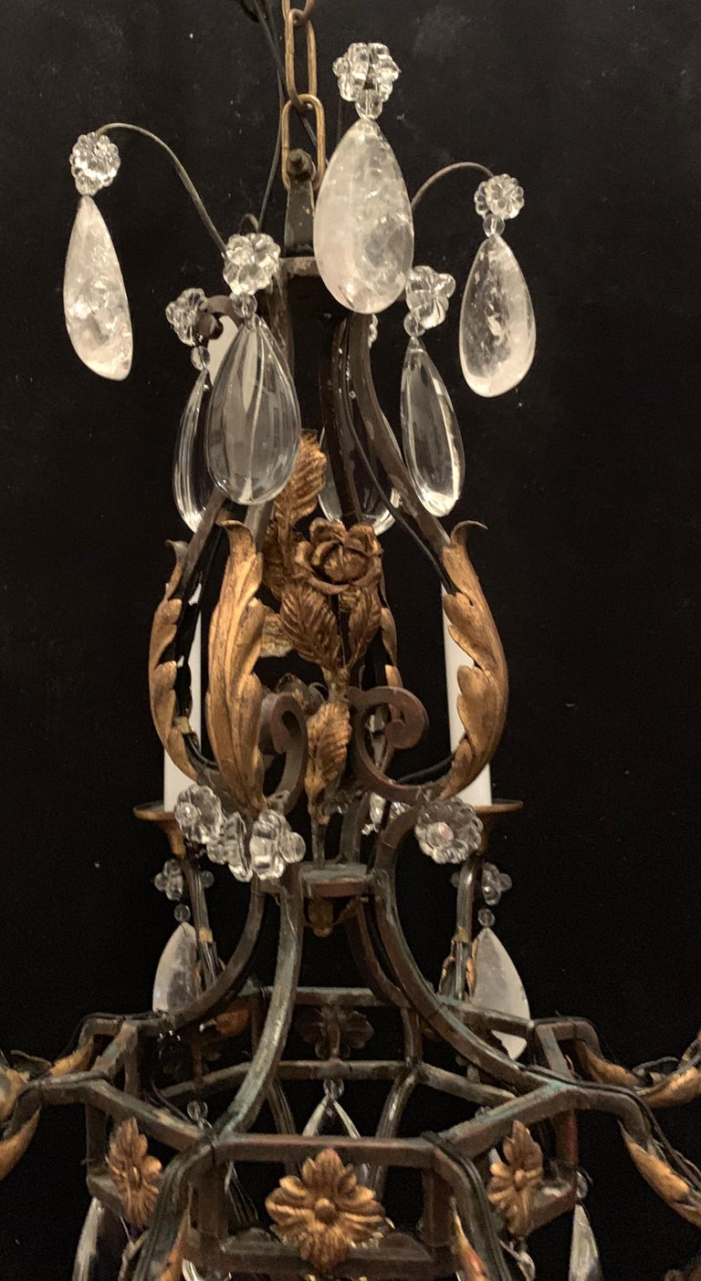 A wonderful French rock crystal and gilt iron flower and leaf bouquet chandelier in the manner of Bagues.