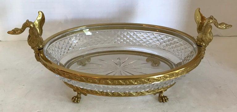 A wonderful French bronze and diamond cut crystal oval centerpiece with swan ormolu handles on paw feet.