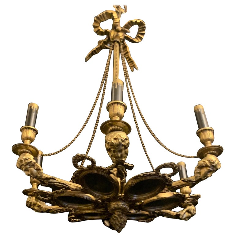 Wonderful French Bronze Oval Mirror Panel Figural Bow Top Ormolu Swag Chandelier For Sale