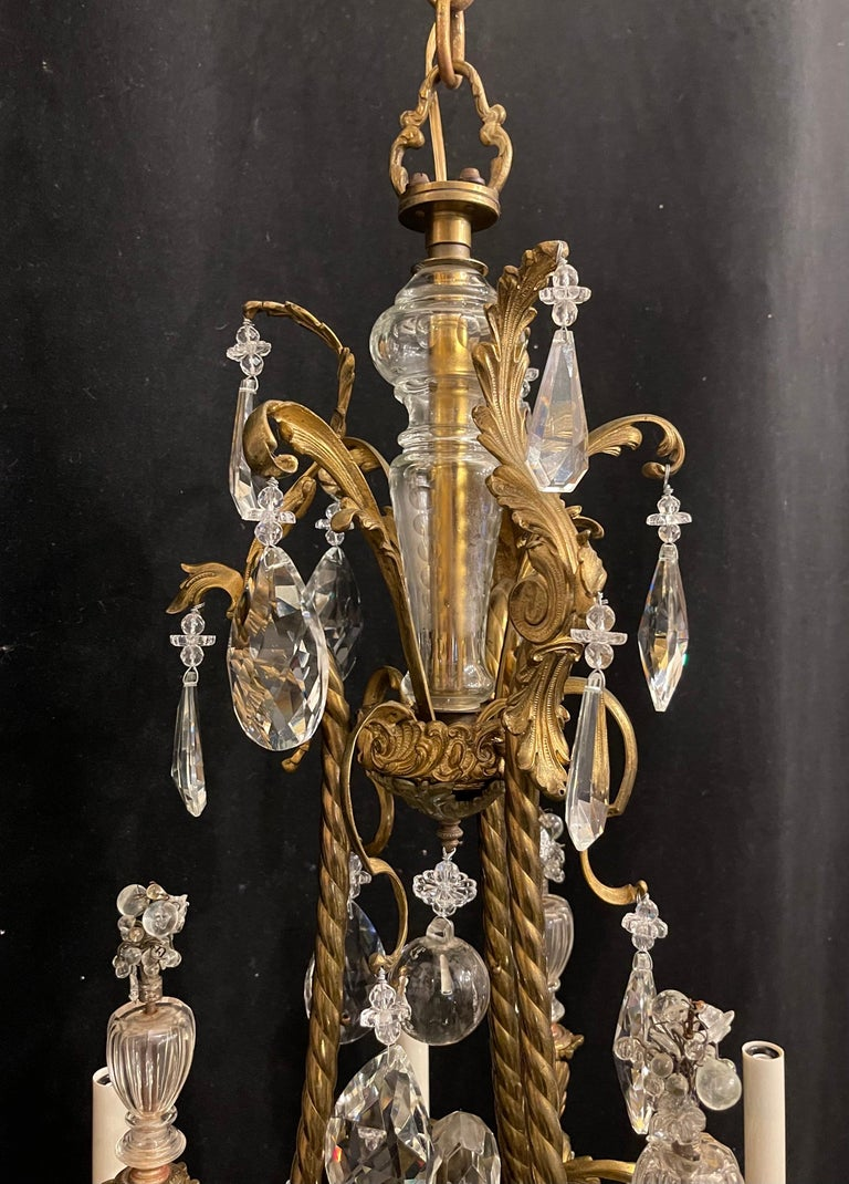 A wonderful French Rococo gilt bronze garland cage & crystal basket chandelier with 6 candelabras light, completely rewired with new sockets and comes with chain canopy and mounting hardware for installation.