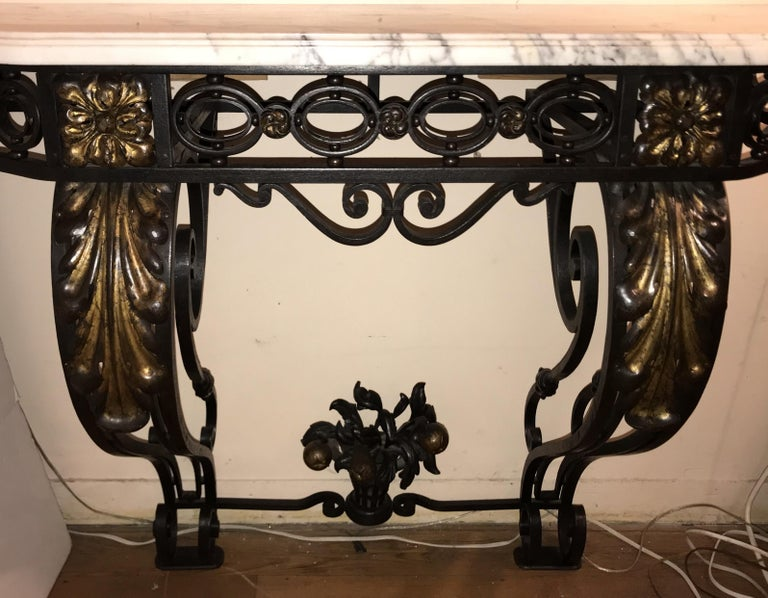Wonderful French, late 19th century Baroque atyle wrought iron and gilt wall mounting console table with Carrera white marble top in the Louis XV style, Paris, circa 1920s.  Measures: 48