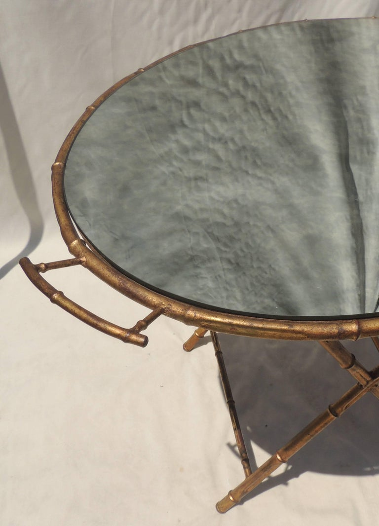 A wonderful gilt tole Baguès, Jansen style bamboo form vintage mirrored removable tray top serving side table finished with handles on both ends.