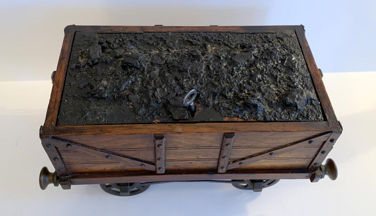 A wonderful oak and tin and bronze fitting humidor in the form of a railway coal wagon / train carriage titled