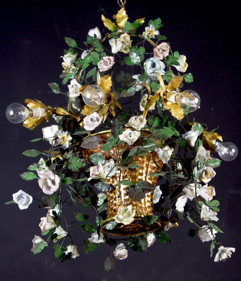 Italian Art Deco Piedmontese cage form chandelier ornamented with colorful porcelain flowers and hand painted tole leaves.