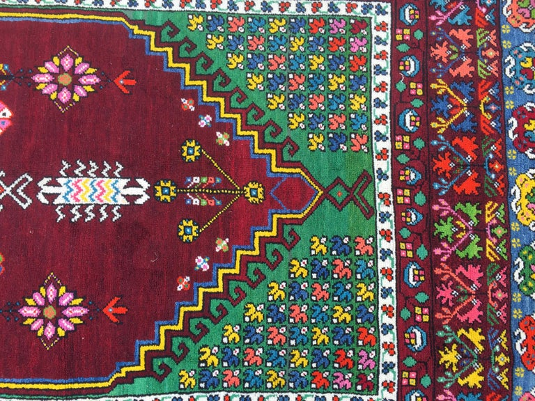 Very beautiful and decorative Moroccan rug from Rabat mid-20th century, geometrical design and nice colors with pink, blue, purple, yellow, green and orange, entirely hand knotted with wool velvet on cotton foundation.