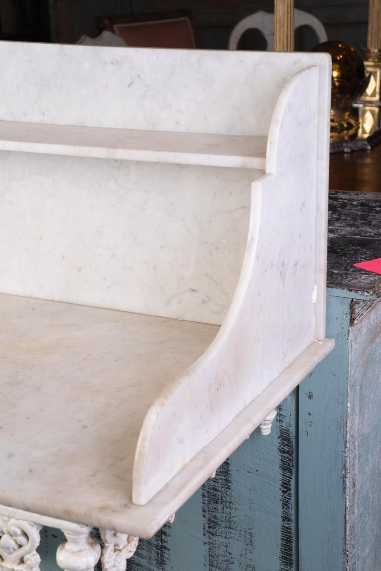 French marble and iron pastry table with original marble shelf.
