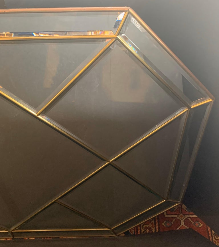 Wonderful Mid-Century Modern brass and beveled panel mirror can be hung either vertical or horizontal in the manner of Karl Springer. Measurements are: 33