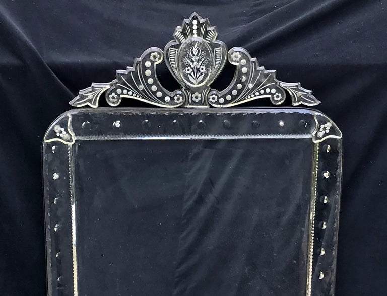 Gorgeous large-scale octagonal Venetian mirror with crown top. Mirror has Fine etched details on top and around the sides as well as beveling.  Dimensions are 63