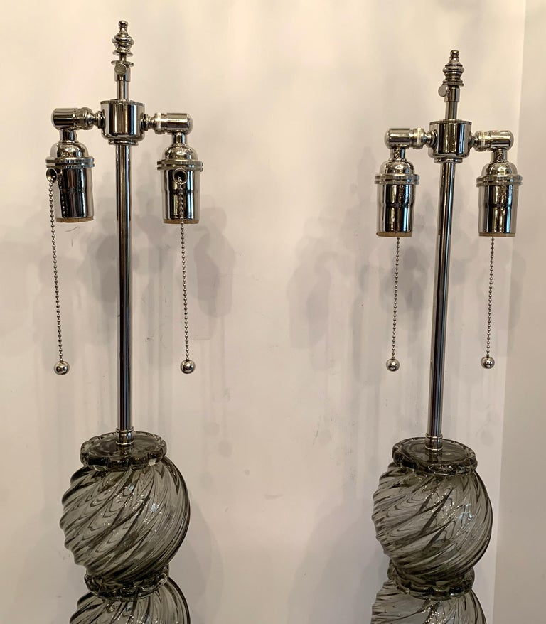 A Wonderful pair of Mid-Century Modern Italian / Murano Venetian swirl form smoke grey color art glass lamps in the Art Deco style with new polished nickel fittings and wiring.