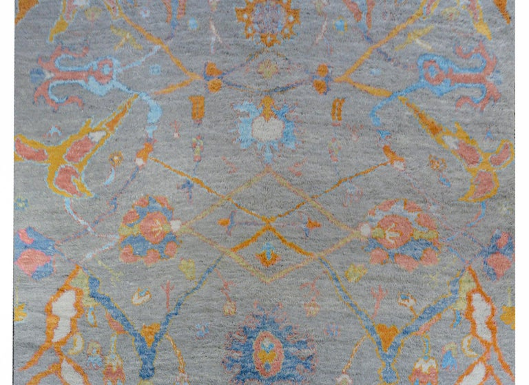 A wonderful contemporary Anatolian Turkish Tulu rug with an all-over multicolored stylized vine and floral pattern a gray background, woven with a thick shaggy pile.