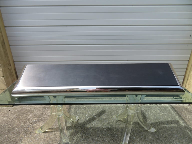 Wonderful Pace collection style chunky chrome wall shelf console table. The top is a brushed charcoal steel laminate which does have some minor scratches-not too noticeable-adds to vintage appeal. This cool piece measures 4