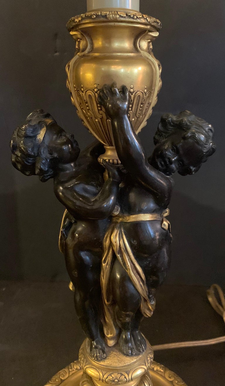 Wonderful Pair E.F. Caldwell Stamped French Bronze Patinated Putti Cherub Lamps In Good Condition For Sale In Roslyn, NY
