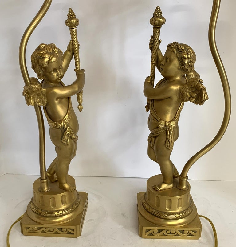 Gilt Wonderful Pair of French Dore Bronze Cherub Putti Figural Torch Lamps Sculptures For Sale