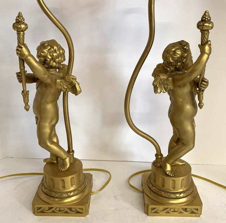 Wonderful Pair of French Dore Bronze Cherub Putti Figural Torch Lamps Sculptures In Good Condition For Sale In Roslyn, NY