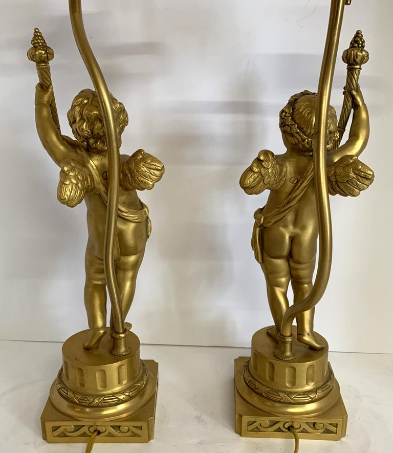 20th Century Wonderful Pair of French Dore Bronze Cherub Putti Figural Torch Lamps Sculptures For Sale