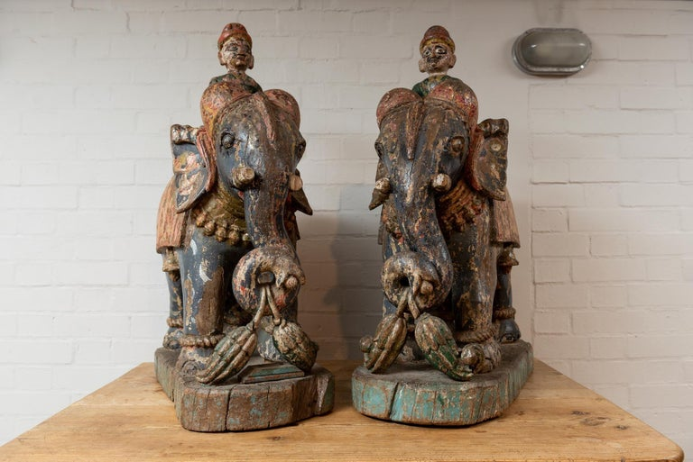 A pair of 19th century wooden elephants from the Rajasthan area in India with their original paint and vibrant colors. Originally they would have stood outside of a home by the front door.