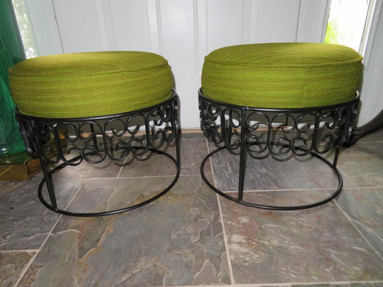 Wonderful pair of Arthur Umanoff stacking stools from the 1964 Grenada Collection for Boyuer Scott, Shaver Howard collections. This pair is in wonderful vintage condition with a lovely lime green lightly ribbed wool fabric and black painted iron