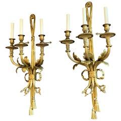 Wonderful Pair of French Bronze Caldwell Three-Arm Ribbon Bow Tassel Sconces
