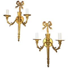 Wonderful Pair of French Doré Bronze Bow Top Flame Two-Light Filigree Sconces