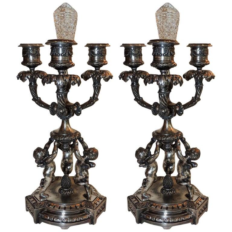 Wonderful Pair of Pairpoint Silvered Bronze Trio Cherub Candelabras Candlesticks For Sale