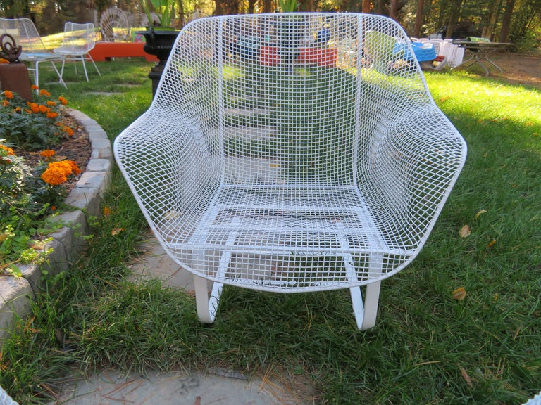 Wonderful pair of 1950s 'Sculptura' lounge chairs designed by Russell Woodard. Woodard's Sculptura collection was made with wrought iron frames and woven steel mesh seats. These are the largest lounge chairs made by Woodard and have the more
