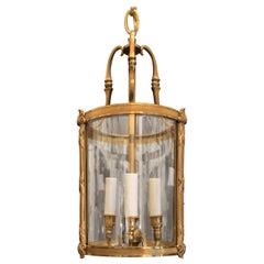 Wonderful Petite Gilt Bronze Readed X-Pattern Curved Glass Lantern Fixture