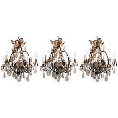 Wonderful Set of Three Baguès French Eight-Light Rock Gilt Crystal Chandeliers