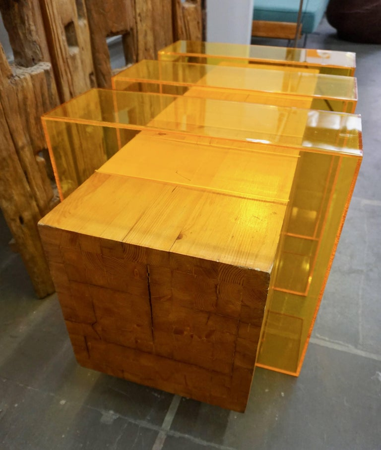 Stacked and laminated pieces of pine wood encased in three sections of amber colored Lucite. Signed by Dayton, Ohio artist Roger Sayre, 1970.