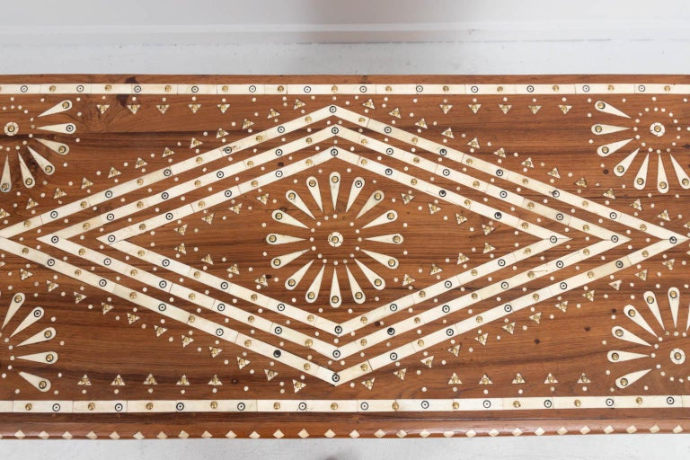 Wooden eight-drawer chest with geometric bone inlay throughout. The piece also features metal studded detail. Please note of wear consistent with age.