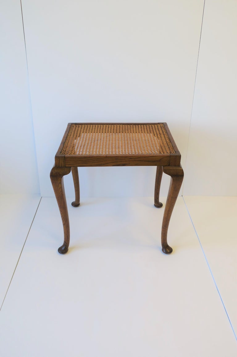 A beautiful rectangular wicker cane top and oak wood frame side or end table in the Queen Anne style with cabriole leg and pad feet, circa early to mid-20th century, Europe. Cane in very good condition as show in images. Table can be positioned two