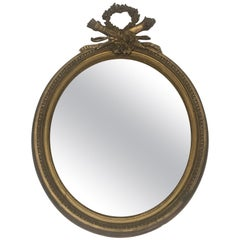Wood and Golden Stucco Louis XVI Style Oval Mirror, French, 19th Century