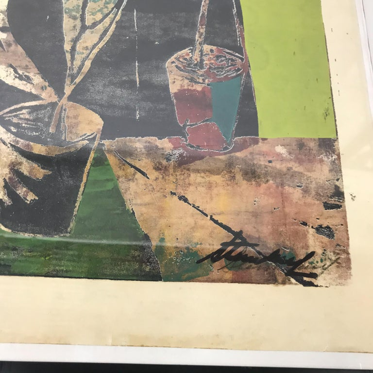For your consideration a wall art in a rectangular shape. The art has an abstract cubism technique. It appears to be a wood block or lithograph.   Dominant color is green and black tones.   The still life shows a woman with three small pots and