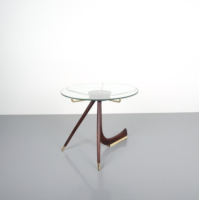 Wood brass coffee or side table, Italy, 1955. Unusually shaped wooden table with brass details and wooden (walnut) base in great condition; hardly any wear, newly polished brass parts. Measures: Height is 20.47