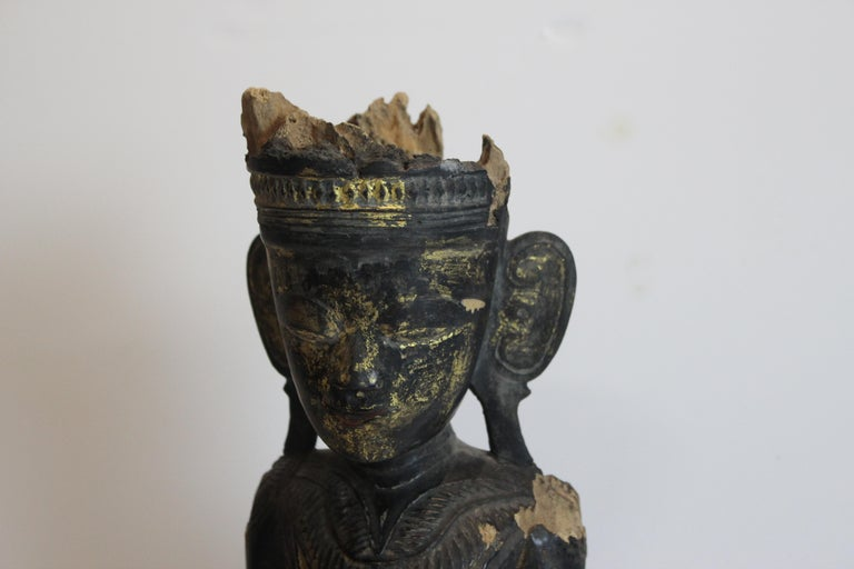 19th century wood carved Buddha. Black and red stain.