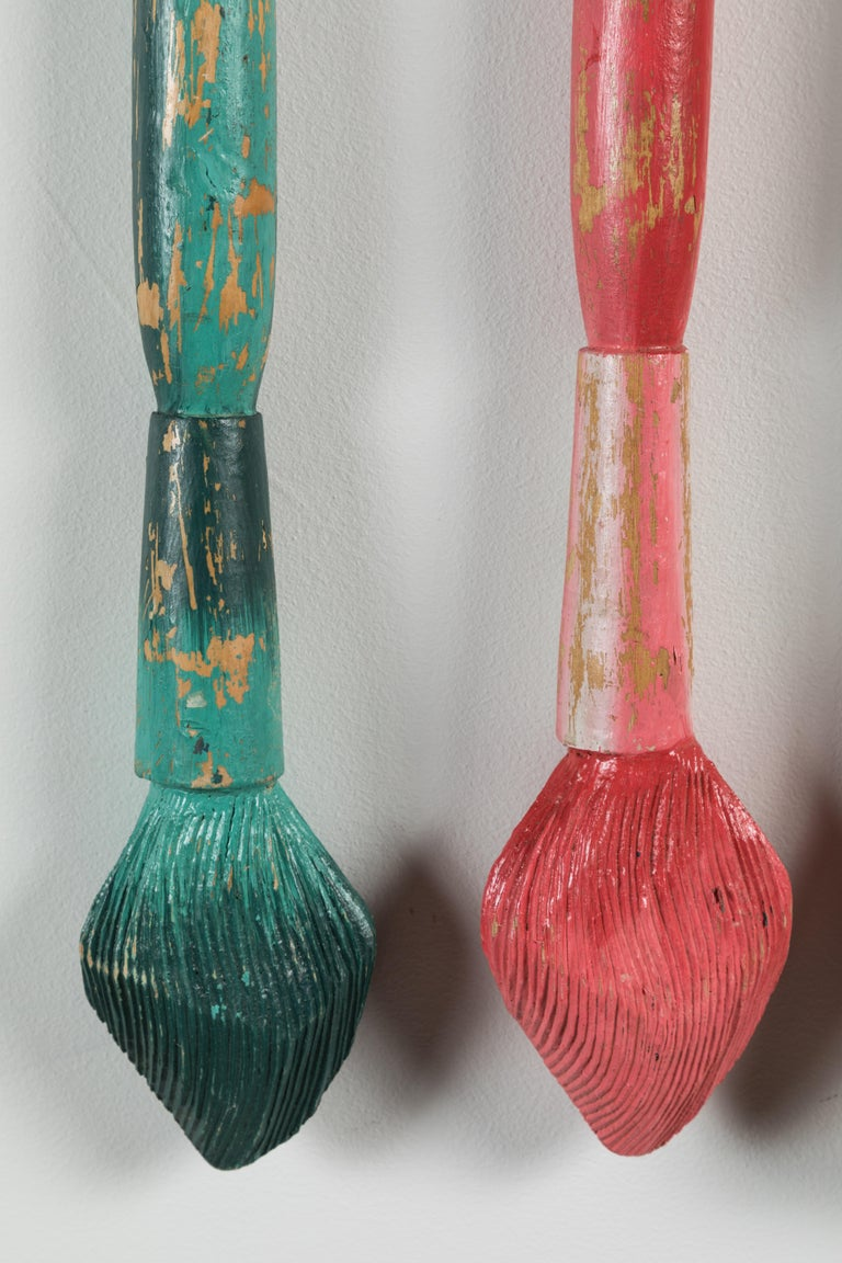 Fantastic hand carved giant wood artist paintbrushes. All original multi colored paint surface. Completely wood carved. Perhaps part of a retail window display or a trade sign. Great American Folk Art. Includes four carved paint brushes and custom
