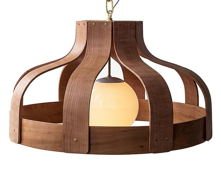 Wood pendants made with a choice of cherry, walnut or maple - handmade in America. This special bending technique uses solid wood only (no veneer).  Wood Pendants: Born out of experiments splicing, bending, binding and stretching various organic