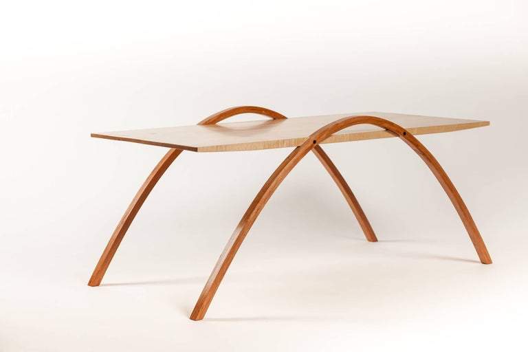 Curly maple table features graceful solid cherry bent-laminated arches and wenge accents. Arched legs create natural hand holds Hand-rubbed finish with fine wax topcoat. This one is currently available. We are proud to represent Fred Rossi, who has