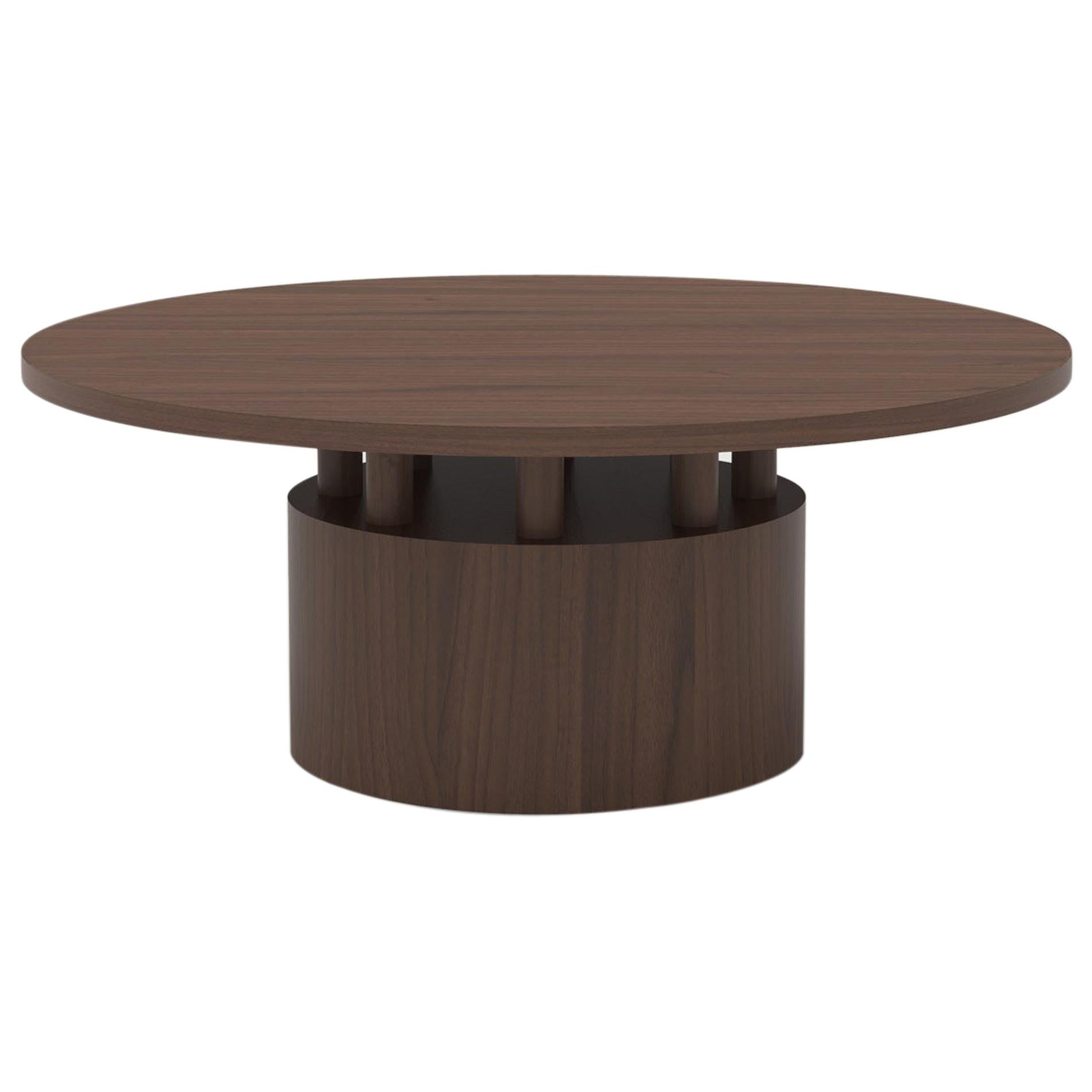 Wood Coffee Table with Round Base and Painted Cylindrical Posts Shown in Oak