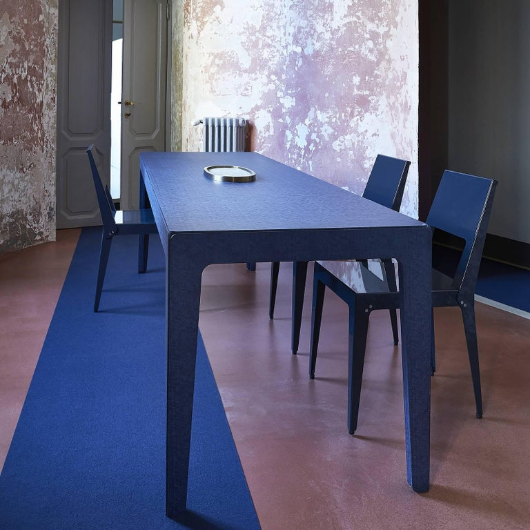Introduced at the Fuorisalone event during 2018 Milan Design Week, this table is made of MDF with blue-stained eucalyptus veneer and has a sleek silhouette that recalls the proportions of the iconic Italian