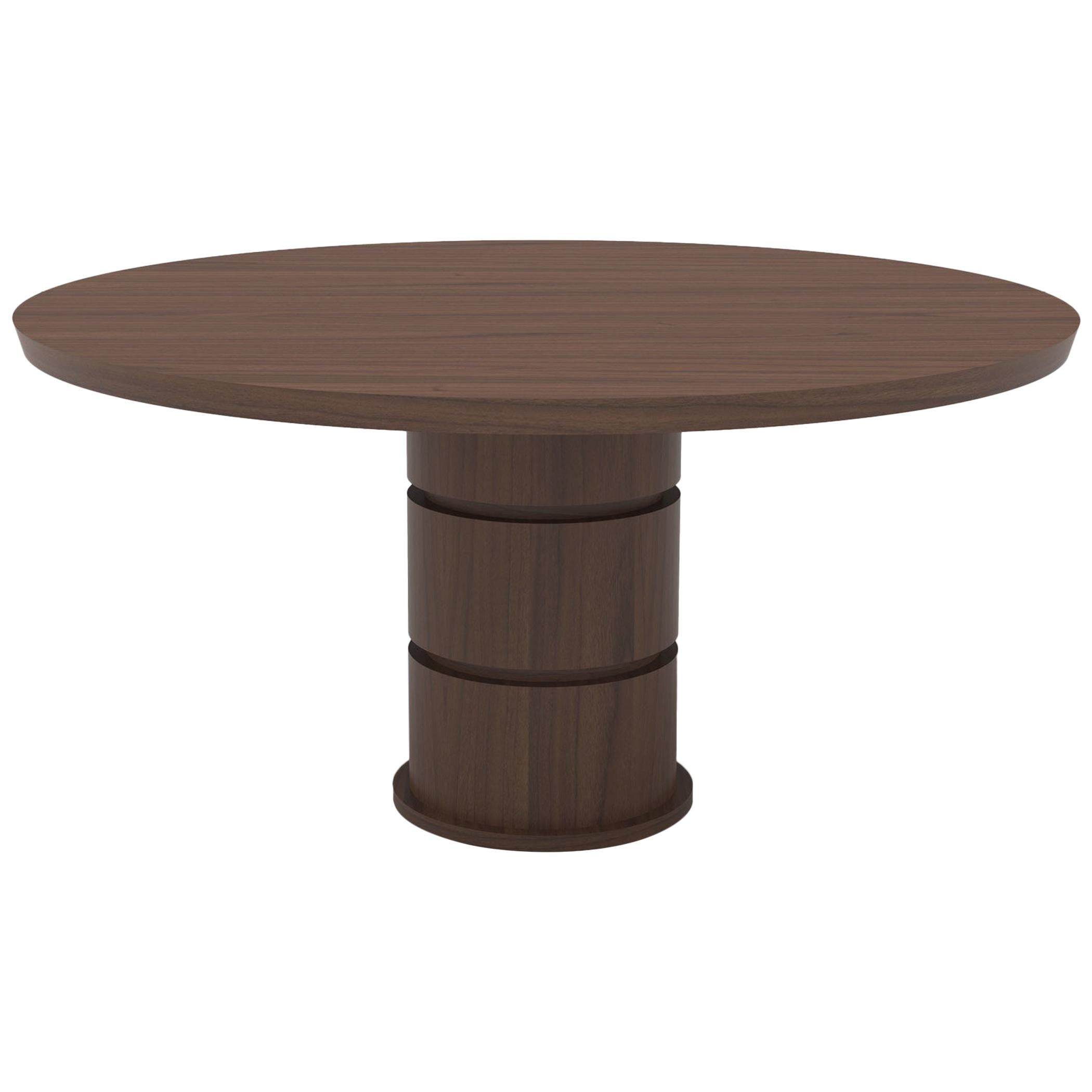 Wood dining table with solid top and cylindrical base with special cut details
