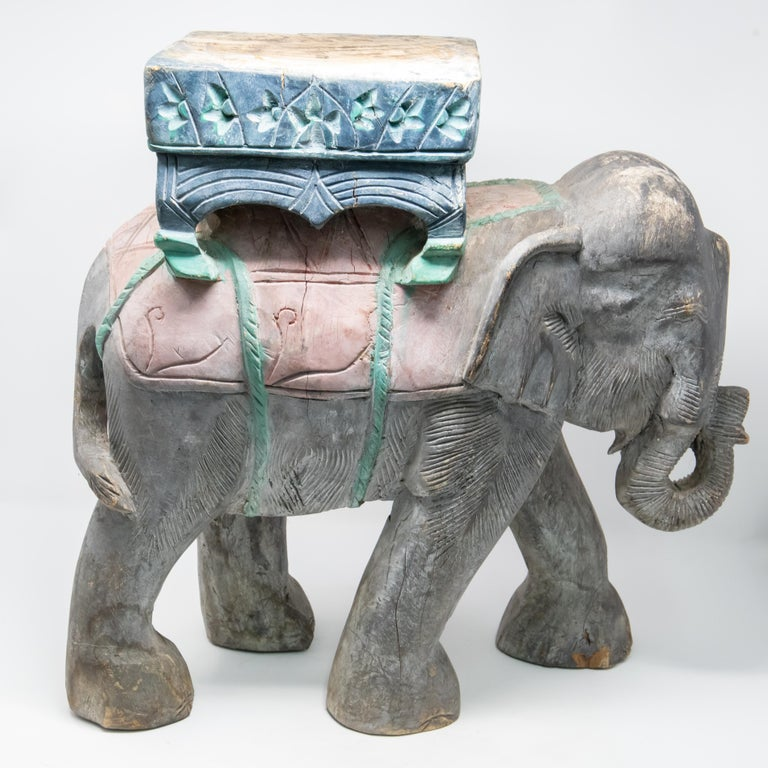 Offering a beautiful elephant plant stand. Hand carved and hand painted the detail is amazing. Elephant is mid stride with his trunk bowed up. Stands strong for a beautiful urn or planter to sit atop this piece.