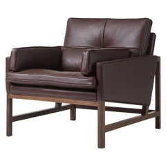 Wood Frame Low Back Lounge Chair in Walnut Black Oil Designed by Craig Bassam
