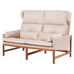 Wood Frame Wing Back Settee in Walnut and Leather Designed by Craig Bassam