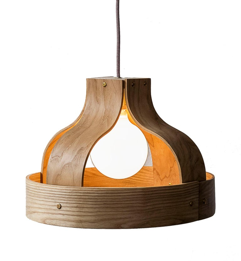 Wood Pendants - made with a choice of cherry, walnut or Maple - handmade in America. This special bending technique uses solid wood only (no veneer).  Wood Pendants: Born out of experiments splicing, bending, binding and stretching various