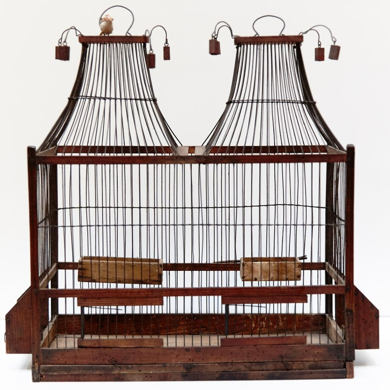 Wood popular traditional bird cage in wood and metal fromFrance, circa 1930  In good original condition, preserving beautiful patina.